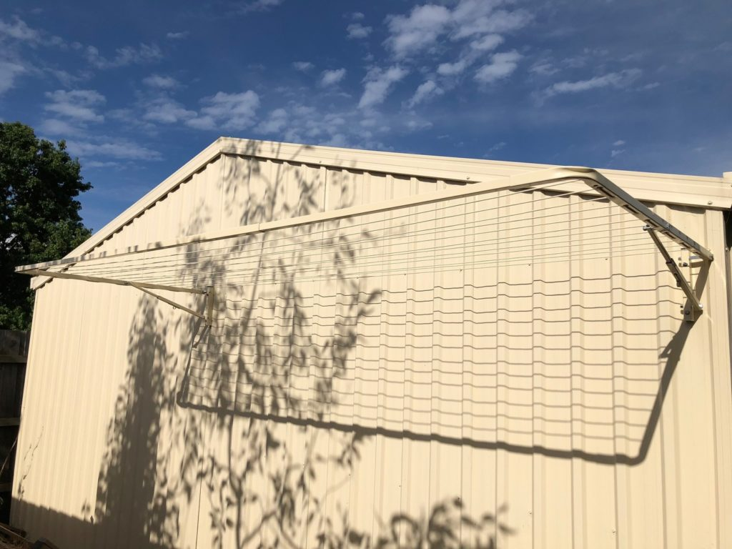 Eco 300 clothesline installed on side of a shed