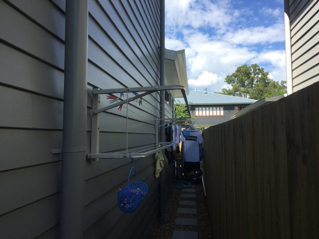 Eco clothesline with Lowline Attachment installed on to weatherboard house
