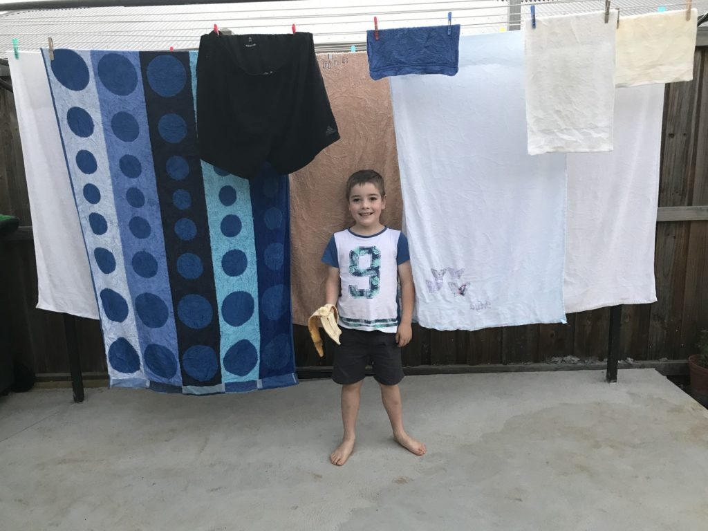 Eco 300 clothesline ground mounted with young boy